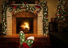 Warming Feet in Holiday Socks by Fire