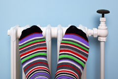 Free Warming Feet On The Radiator Stock Image - 22021051