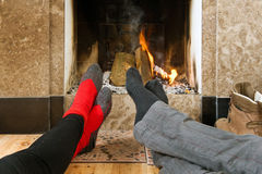 Warming by the fire Royalty Free Stock Photos