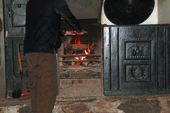 Warming hands on an old fashioned log fire Stock Photo