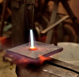 Warming an iron. Stock Photography