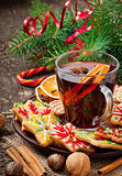 Warming mulled wine, spices and gingerbread cookie Stock Images