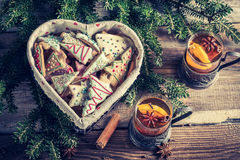Warming tea with cinnamon and sweet cookies for Christmas Royalty Free Stock Photo