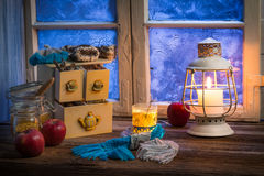 Warming tea in a winter cottage Royalty Free Stock Images