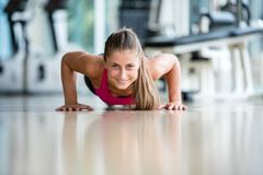 Warming up and doing some push ups a the gym Stock Photos