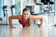 Warming up and doing some push ups a the gym Stock Photography