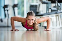 Warming up and doing some push ups a the gym Royalty Free Stock Image
