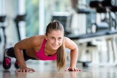 Warming up and doing some push ups a the gym Stock Photo