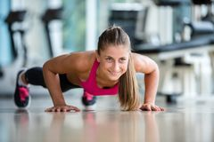 Warming up and doing some push ups a the gym Stock Images