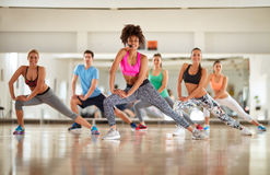 Warming up exercises with female instructor Stock Photos