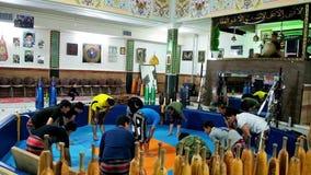 Warming-up exercises before training Zurkhaneh sport club in Iran. KERMAN, IRAN - OCTOBER 15, 2017: Athletes do the warm-up exercises before the training in stock footage
