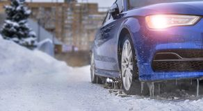 Warming up the icy car. Starting engine and warming up the icy car in severe frosts in winter royalty free stock photography