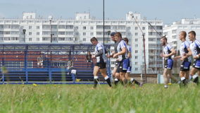 Warming up - Rugby players run on a stadium before a match stock footage