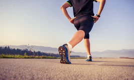 Warming up runner on the road close up image Royalty Free Stock Images