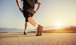 Warming up runner on the road close up image Stock Images