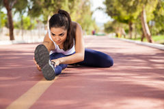 Warming up at a running track Royalty Free Stock Images