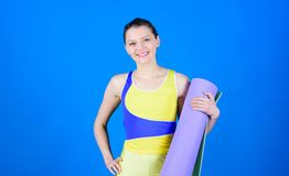 Warming up before training. Yoga class concept. Yoga hobby and sport. Practicing yoga every day. Girl slim fit athlete. Hold fitness mat. Fitness and stretching stock photo
