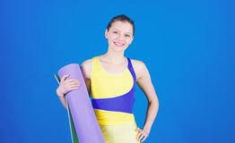 Warming up before training. Yoga class concept. Yoga hobby and sport. Practicing yoga every day. Girl slim fit athlete. Hold fitness mat. Fitness and stretching royalty free stock photography