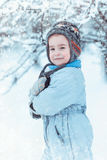 Warmly dressed boy playing in winter forest Royalty Free Stock Images