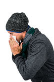 Warmly dressed man blowing his nose Stock Photo
