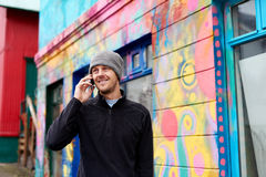 Warmly Dressed Man Talking On His Mobile Stock Photos