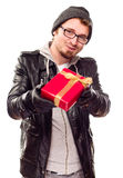 Warmly Dressed Young Man Handing Wrapped Gift Out Stock Image