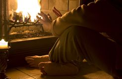 Warmth by the Fire. Man warming himself by a blazing fire Stock Photography