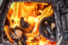 Warmth. A fire place provides amazing warmth away from the snow and ice royalty free stock photos