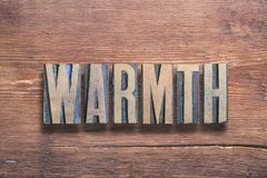 Warmth letters wood. Warmth word combined on vintage varnished wooden surface royalty free stock photography