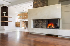 Warmth and luxury of an elegant fireplace stock images