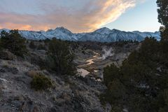 The warmth of sunset over the towering Sierra Nevada Mountains