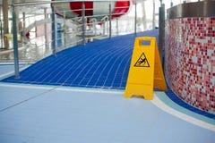 Warnen von glatten Böden Stockbilder