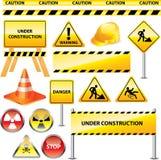 Warnende und im Bau Zeichen Stockbilder