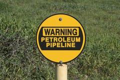 Warnendes Erdöl-Rohrleitungs-Zeichen Stockbild