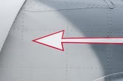 Warning arrow on metal Royalty Free Stock Photo