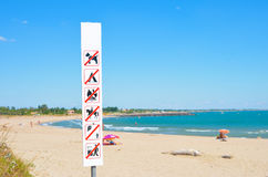 Warning on the beach that is forbidden stock image