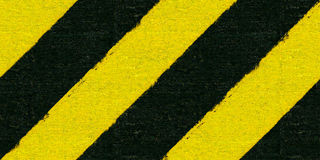 Warning black and yellow hazard Royalty Free Stock Image