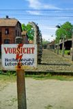 Warning board in death camp Auschwitz Stock Photography