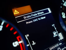 Warning of Brake Pad Wear. On a dashboard Stock Photos