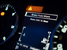 Warning of Brake Pad Wear. On a dashboard, shallow depth of field Stock Image
