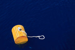 Warning buoy off the coast of Maine against a foggy background, Buoy on the sea for support supply boat. Royalty Free Stock Photo