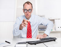 Warning: businessman with a red tie showing with his index finge Royalty Free Stock Image