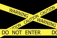 Warning and Caution  and Do Not Enter yellow tapes Royalty Free Stock Photo