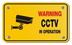 Warning cctv in operation yellow sign - rectangle sign Stock Images