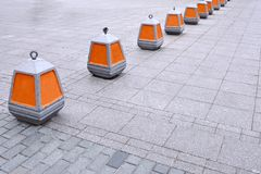 Warning cone on the prohibition to enter the orange color on the sidewalk.  stock images