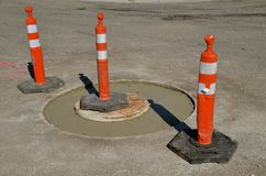Warning cones around sanitary sewer repair project Royalty Free Stock Photography