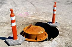 Warning cones around sanitary sewer repair project Stock Photography