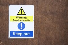 Warning construction building site sign keep out health and safety caution for workers and public people. Board at entrance workplace Stock Images