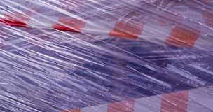 Construction tape covered in plastic. background, industrial. Warning construction tape covered in plastic. background, industrial royalty free stock photography