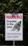 Warning, Coyotes in the Area in park , Canada Royalty Free Stock Images
